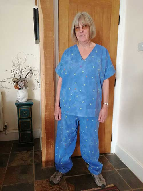 WI member Maggie in scrubs